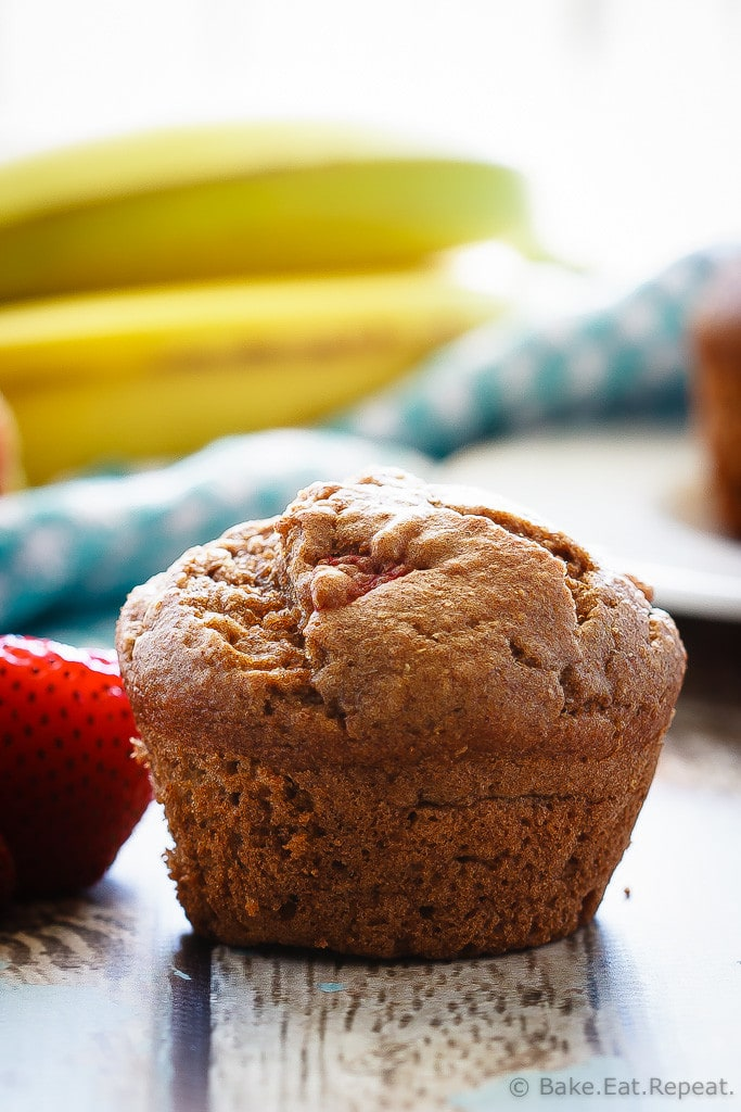 Whole Wheat Strawberry Banana Muffins - These whole wheat strawberry banana muffins are easy to make, light and fluffy muffins that are a healthy choice for breakfast or a snack!