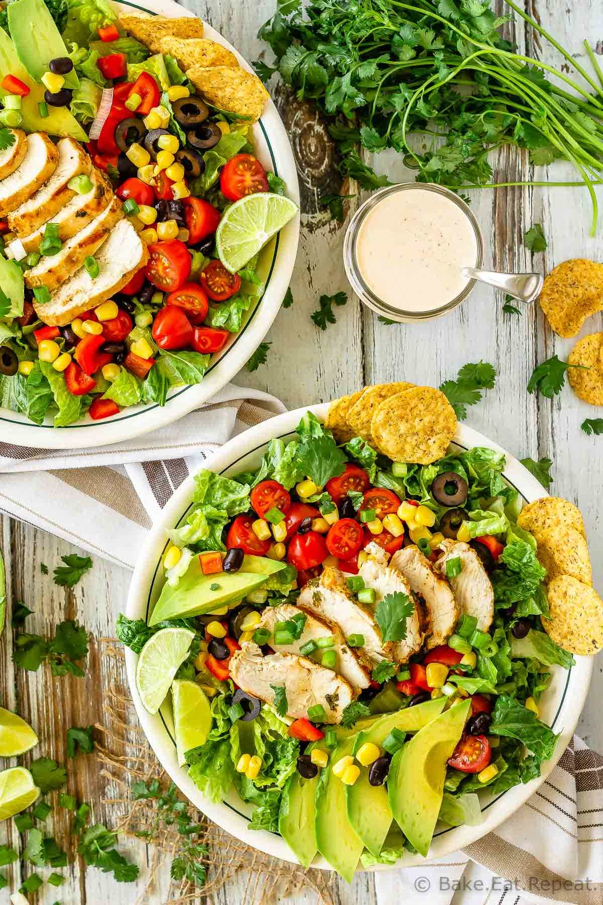 This chicken taco salad is one of our favourite meals - juicy, grilled cilantro lime chicken tossed with salad, tortilla chips and tasty taco ranch dressing!