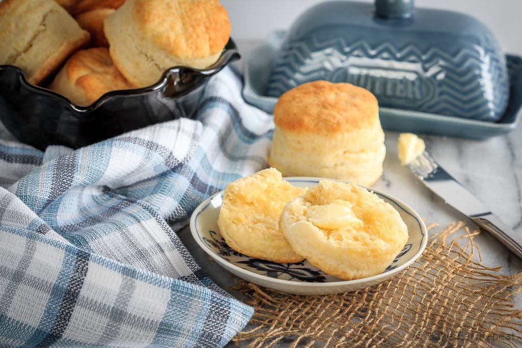 These homemade cream biscuits use only 4 ingredients, take just minutes to mix up, and result in wonderfully flaky homemade biscuits you will love! The perfect easy side dish for any meal, or even for breakfast warmed up with some jam!