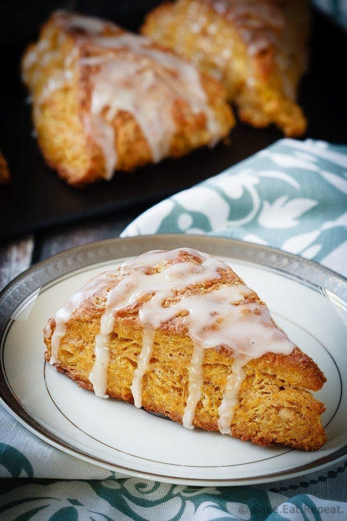 Light and fluffy pumpkin scones topped with a sweet maple glaze. These scones are the perfect breakfast treat to enjoy with your morning coffee!