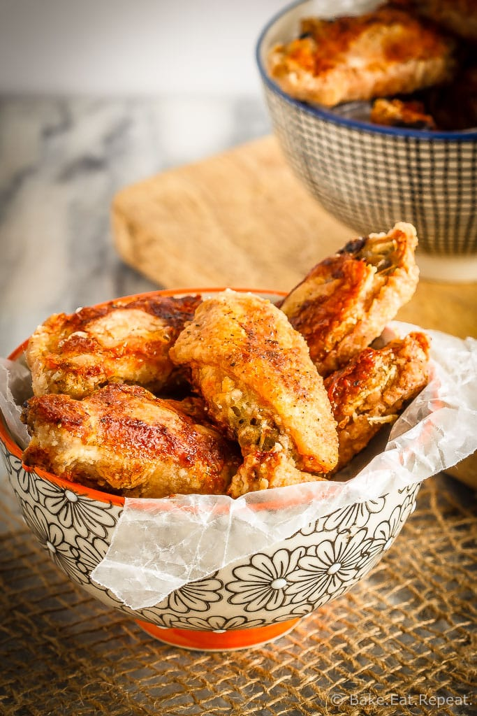 These oven baked wings are super crispy and so easy to make. Toss them with your favourite sauce for perfect wings that are baked instead of fried!