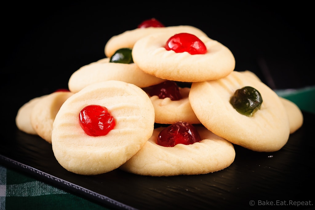 These light and sweet whipped shortbread cookies, with a cherry on top, are so quick and easy to make. Christmas cookie perfection.