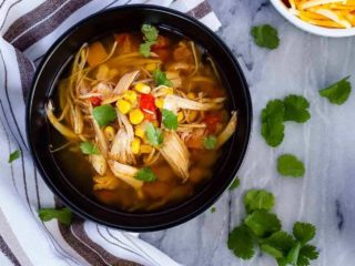 Instant Pot or slow cooker chicken taco soup - the easiest soup to toss together, and so full of flavour. The whole family will love it!