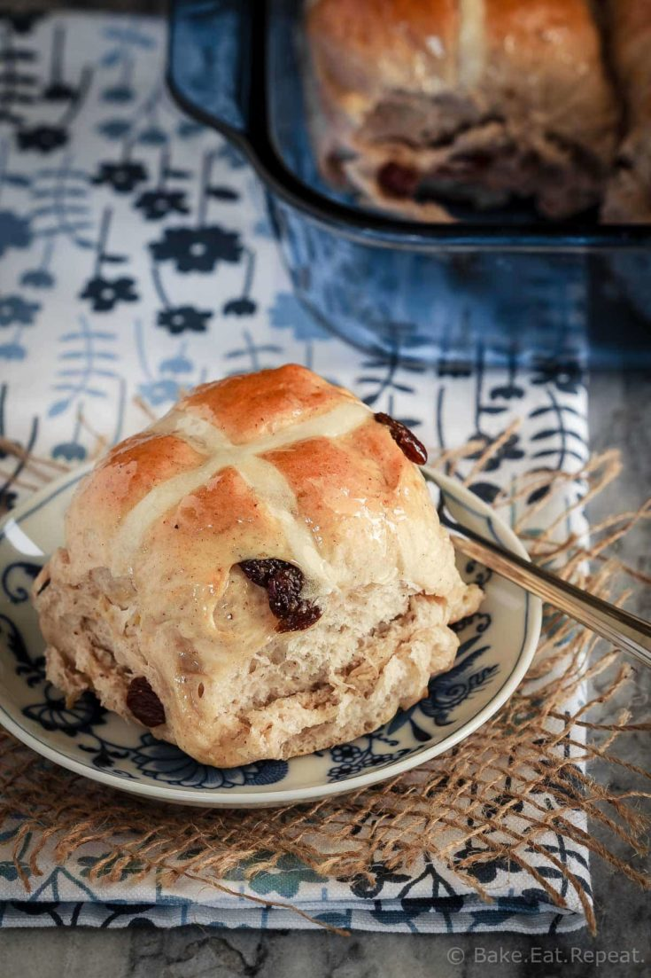 Soft and fluffy hot cross buns filled with raisins and topped with a honey lemon glaze - they make the perfect treat for the Easter season!