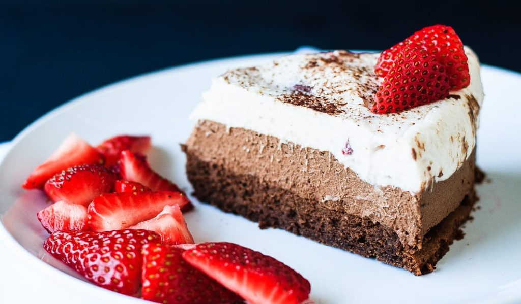 Chocolate Mousse Cake - A decadent triple chocolate strawberry mousse cake that is perfect for a special occasion. Flourless chocolate cake, dark chocolate mousse, and a white chocolate strawberry mousse - a chocolate lover's dream!