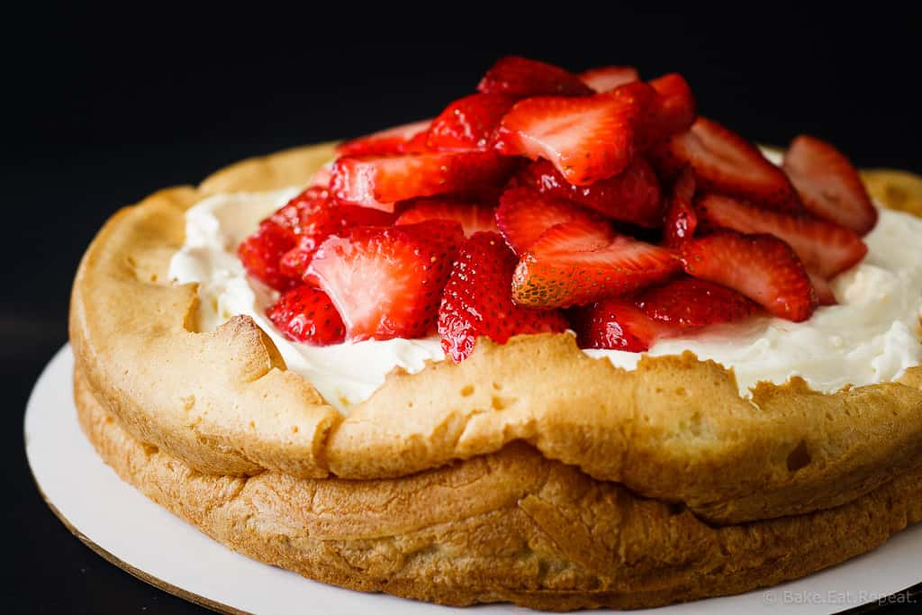 Lemon Strawberry Cream Puff Cake - An amazing lemon strawberry cream puff cake that is absolutely stunning. A giant cream puff shell filled with lemon curd, then a creamy whipped filling and topped with fresh strawberries. This dessert will not last long!