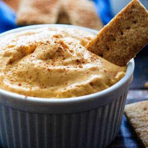 Pumpkin Pie Dip - A quick and easy pumpkin pie dip that tastes just like pumpkin pie, but in dip form! Serve it with graham crackers and fruit for a perfect light dessert!