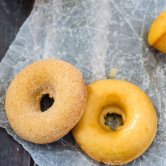 Baked Pumpkin Spice Doughnuts - Quick and easy baked pumpkin spice doughnuts (or doughnut holes!) coated with either a sweet maple glaze or cinnamon sugar. Either way - they're absolutely amazing!