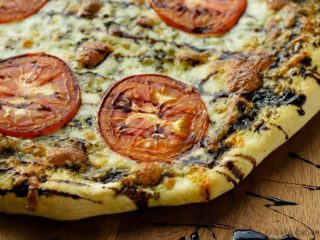 Caprese Pizza - Easy caprese pizza with pesto, mozzarella and tomatoes, and drizzled with balsamic glaze.