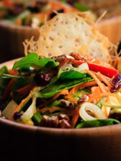 Carrot, Apple and Cucumber Salad - Amazing carrot, apple and cucumber salad with candied pecans and asiago crisps, all drizzled with a red wine vinaigrette.