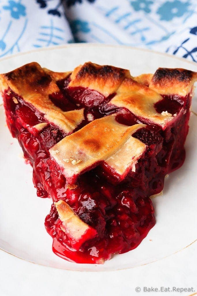 Easy to make raspberry pie can be made with either fresh or frozen raspberries. This is the perfect dessert - tart, sweet, perfect raspberry pie!
