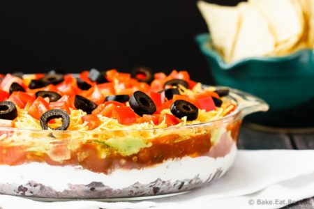 Mexican 7 Layer Dip - Quick and easy Mexican 7 layer dip - takes minutes to make and is an absolutely fantastic appetizer or snack. Everyone will love this!
