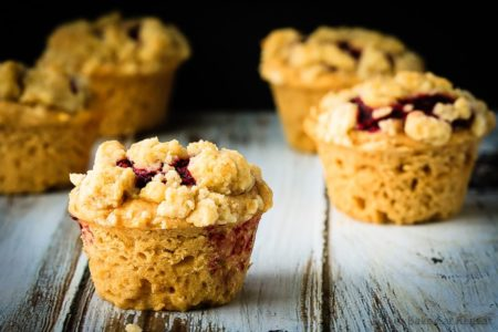 Peanut Butter and Jelly Muffins - Amazing peanut butter and jelly muffins - light and fluffy peanut butter muffins with a homemade raspberry jam filling and a buttery crumb topping!