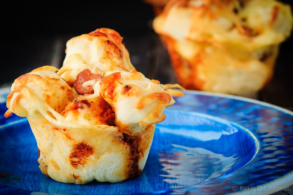 Pull Apart Pizza Muffins - Easy to make, pull apart pizza muffins that are perfect for supper or a snack, or as an easy on-the-go meal. The whole family will love these pizza muffins!