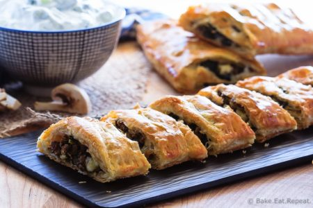 Beef Spinach and Mushroom Strudel - An easy appetizer made with puff pastry that everyone will love - this savoury strudel is filled with ground beef, mushrooms, spinach and feta cheese and served with tzatziki dip.