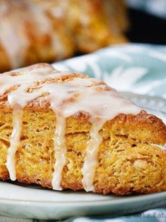 Pumpkin Scones - Light and fluffy pumpkin scones topped with a sweet maple glaze. These scones are the perfect breakfast treat to enjoy with your morning coffee!