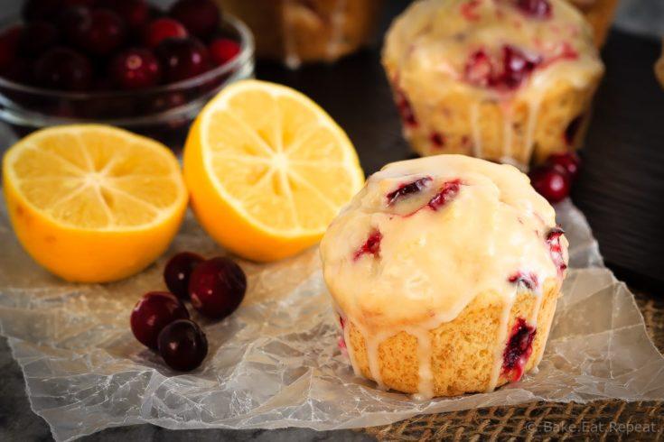 Glazed Lemon Cranberry Muffins - These glazed lemon cranberry muffins are light and fluffy with the tart, fresh cranberries complimenting the sweet lemon glaze perfectly!