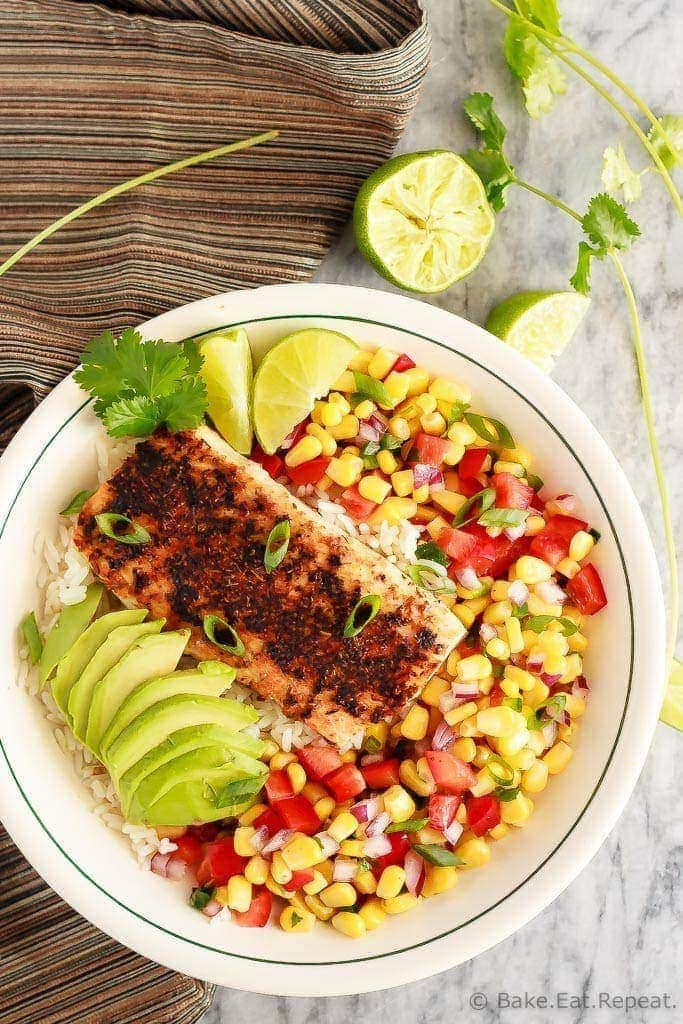 These blackened fish taco bowls with corn salsa are quickly becoming a family favourite!  Spicy fish, fresh avocado, and corn salsa served on hot rice.