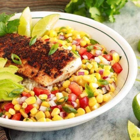 These blackened fish taco bowls with corn salsa are quickly becoming a family favourite! Spicy fish, fresh avocado, and corn salsa served on hot rice. So good!