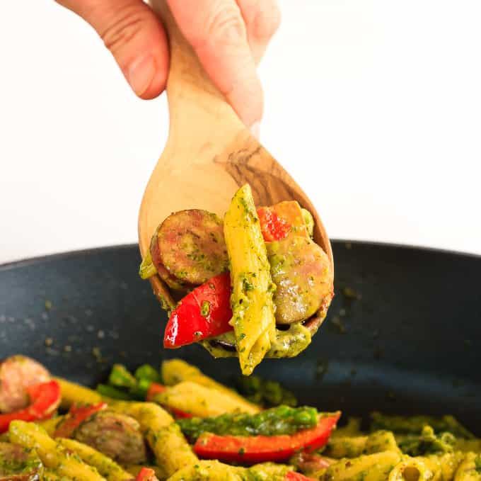 This quick and easy one pot pesto pasta with chicken sausage, asparagus and red peppers is an easy weeknight meal that the whole family will love!