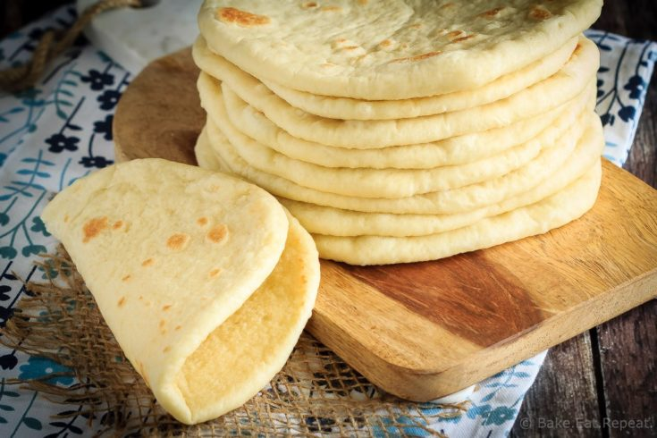 This homemade soft flatbread recipe is super easy to make and is perfect for sandwiches, gyros or even mini pizzas!