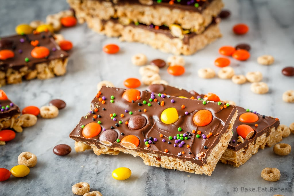 These crunchy chocolate peanut butter granola bars use cereal and oats for an easy, no bake treat - with yellow and orange candy for a fun Halloween snack!