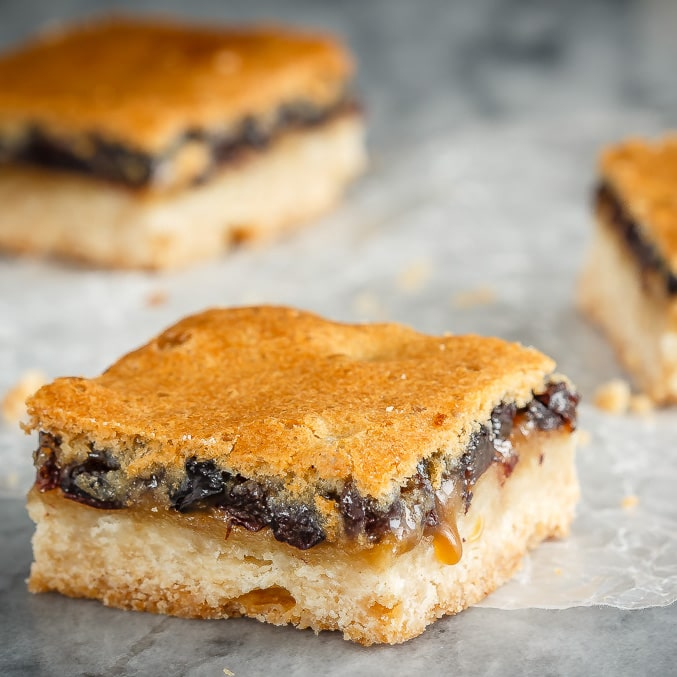 These butter tart squares are butter tarts in bar form - a shortbread base with a sweet topping made with butter, sugar and currants. Perfect for your holiday baking!