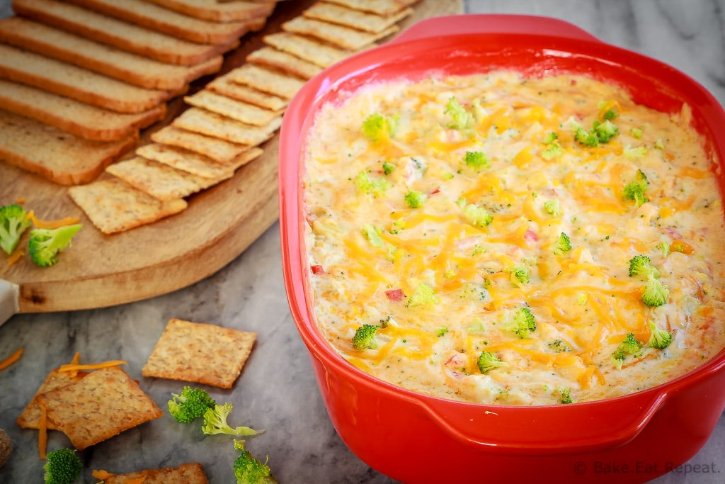 This hot, baked broccoli cheese dip is easy to mix up and can be made ahead of time. Everyone will love this appetizer served with crackers, chips or veggies!