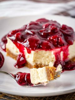 These easy cherry cheesecake bars make the perfect summer dessert - decadent cheesecake topped with a fresh cherry sauce!