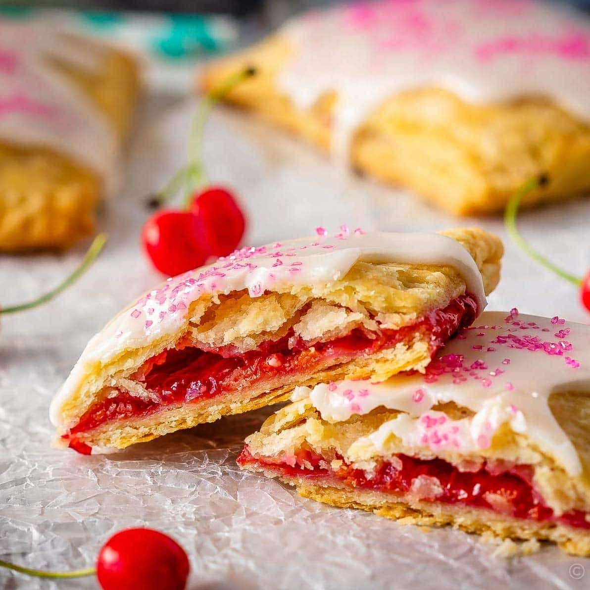 These cherry pop tarts are easy to make, and make the best dessert or snack. Flaky homemade pastry wrapped around a sweet cherry filling - so good!