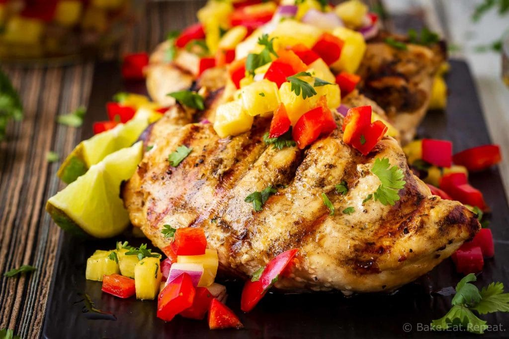 This lemon garlic grilled chicken with pineapple salsa is quick and easy to make and is the perfect summer meal! Juicy grilled chicken with fruit salsa!