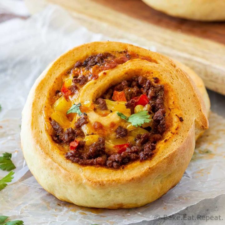 These taco pizza rolls are easy to make and taste amazing! Homemade pizza dough wrapped around taco meat, cheese and veggies - perfect for lunch or dinner!