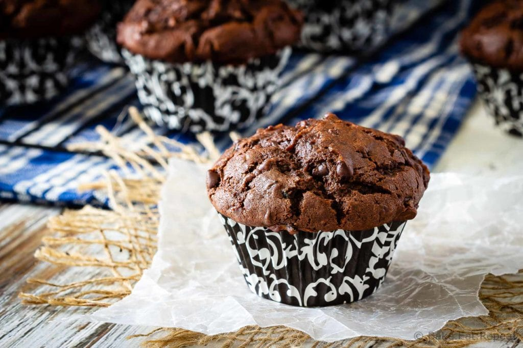 These chocolate zucchini muffins are a great way to use up all that garden zucchini! Moist, chocolatey, delicious muffins that everyone will love!