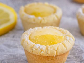 These lemon sugar cookie cups are like mini lemon pies with a sugar cookie crust - easy to make, they're the perfect little sweet treat!