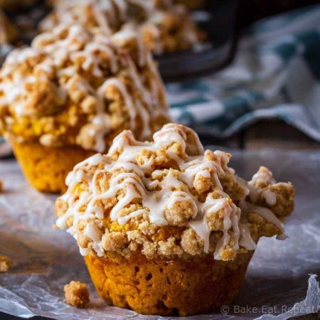 These bakery style pumpkin spice muffins are delicious on their own - but add that crumb topping and drizzle them with a maple glaze and they're amazing!