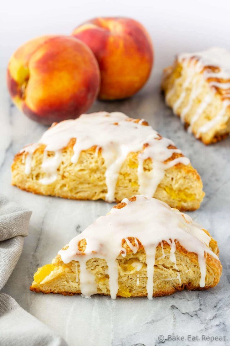 These peach scones, filled with fresh peaches and topped with vanilla glaze, are tender and flaky and make the perfect sweet treat with your morning coffee!