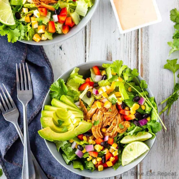 BBQ Chicken, corn, red peppers, black beans, and avocado in a romaine salad with creamy cilantro lime dressing