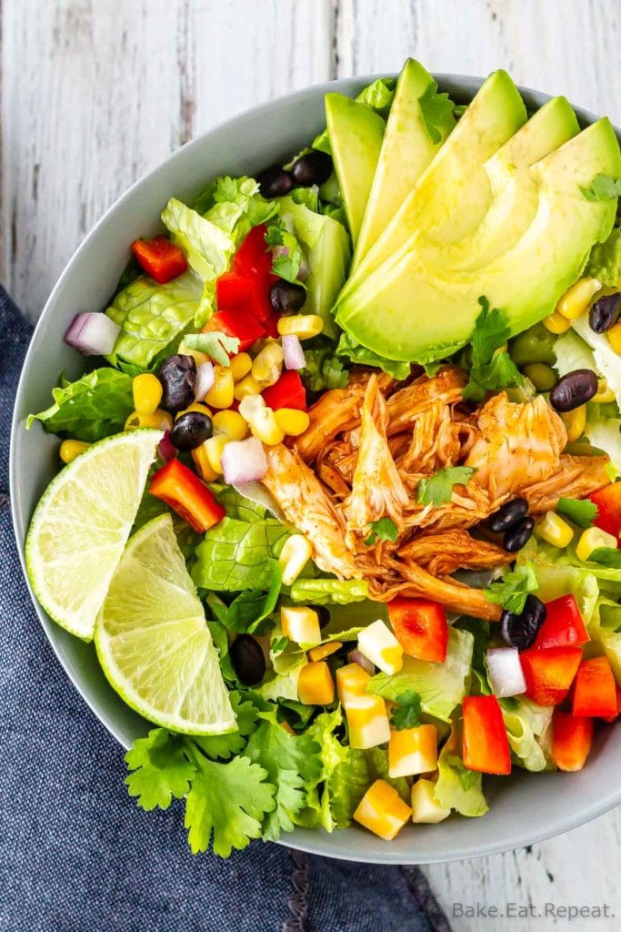 BBQ chicken chopped salad with corn, black beans, romaine lettuce, red pepper, red onion, and avocado and a creamy cilantro lime dressing.