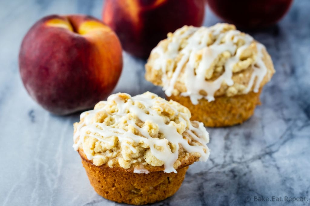 Peach crumb muffins with a vanilla glaze