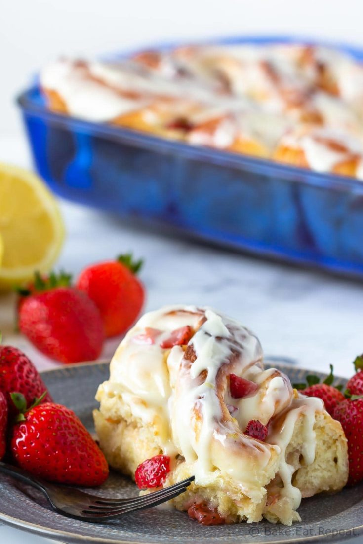These strawberry lemon sweet rolls make the perfect sweet treat for brunch! Filled with fresh strawberries and covered in a sweet lemon cream cheese glaze, everyone will love them!