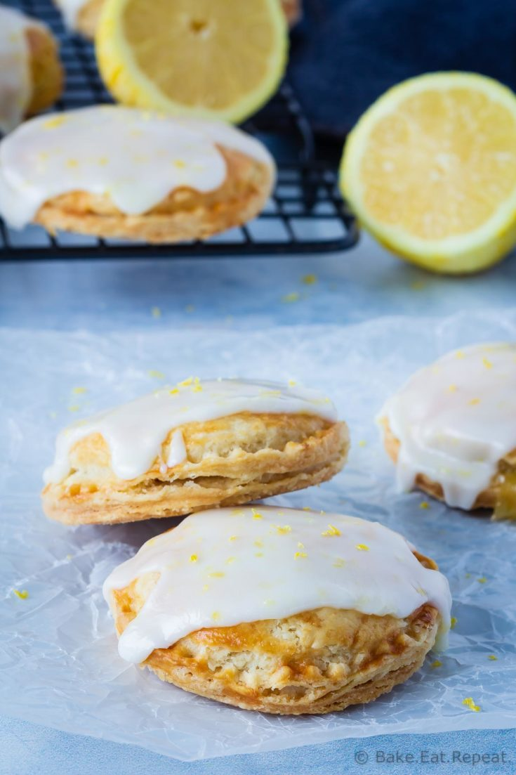 These cute little lemon hand pies are so easy to make for the perfect dessert or snack. Flakey pie crust filled with lemon curd and topped with lemon frosting!