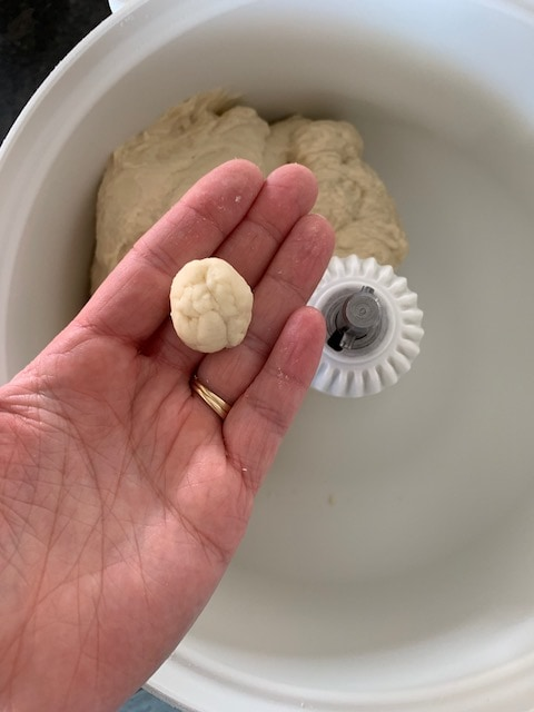 Bread dough rolled into a ball to show what it should look like if floured correctly.