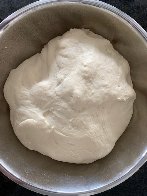 Bread dough after rising until doubled.