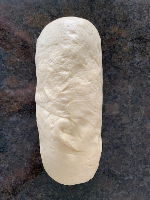 Bread dough shaped into a loaf.