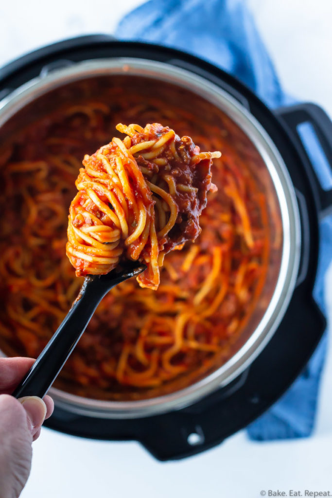 Spaghetti and meat sauce in the Instant Pot with a scoop of spaghetti.