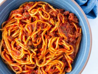 A bowl of spaghetti and meat sauce cooked in the pressure cooker.
