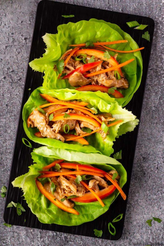 Slow cooker hoisin chicken lettuce wraps on a platter.