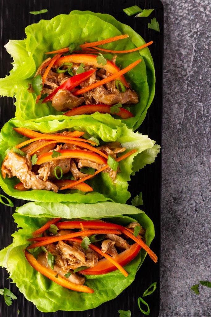 Hoisin chicken lettuce wraps on a platter.