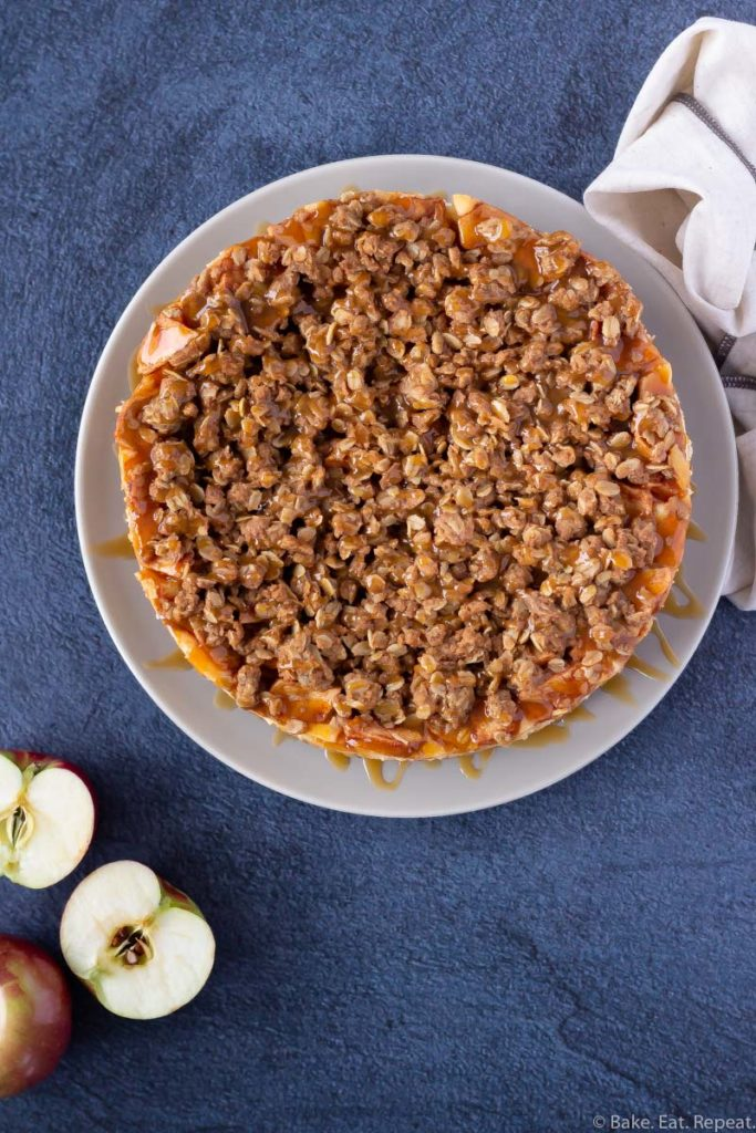 Easy to make apple crisp cheesecake with caramel sauce.