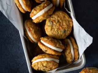 carrot oatmeal raisin sandwich cookies with cream cheese frosting